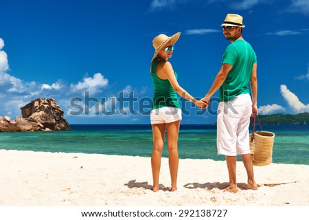 Couple relaxing on a tropical beach at Seychelles, La Digue.  - stock photo