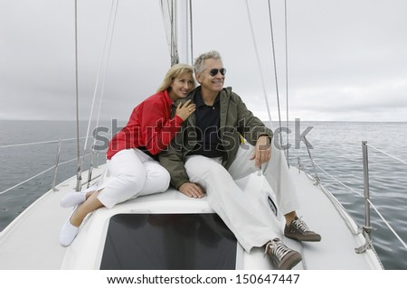 Couple relaxing on yacht - stock photo