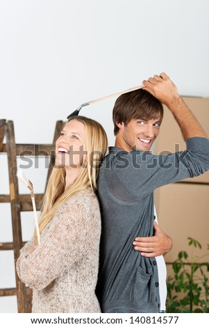 couple renovating their home and having fun - stock photo