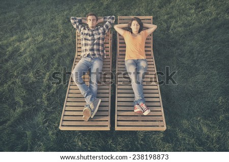 Couple resting on the couch - stock photo