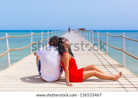 Couple resting on the pier of Red Sea, Egypt - stock photo