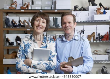 Couple Running Online Shoe Business - stock photo