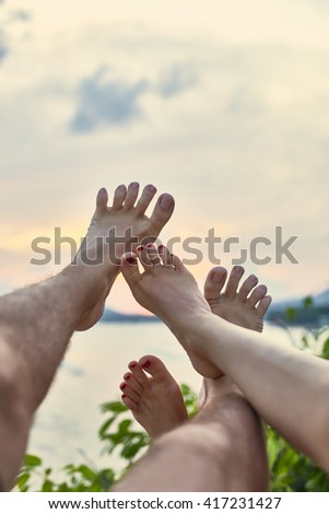 Couple's feet having fun. vacation concept - stock photo
