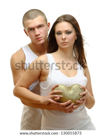 Couple Sexy holding gold heart - stock photo