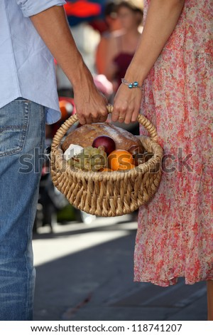 Couple shopping at local market - stock photo
