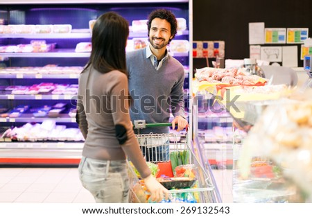 Couple shopping at the grocery store - stock photo