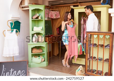 Couple Shopping In Vintage Clothing Store - stock photo