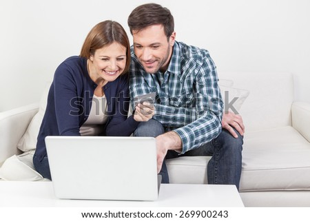 Couple shopping online - stock photo