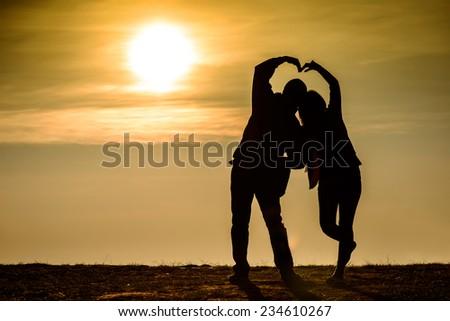 Couple silhouette, sunrise photo of love - stock photo