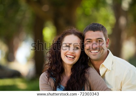 Couple sitting in the garden - stock photo