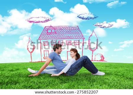 Couple sitting on the floor against blue sky over green field - stock photo