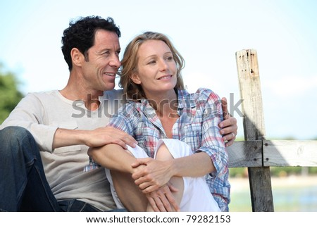 Couple sitting outside - stock photo