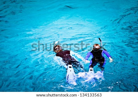 Couple skorkelling on the Great Barrier Reef, Australia - stock photo