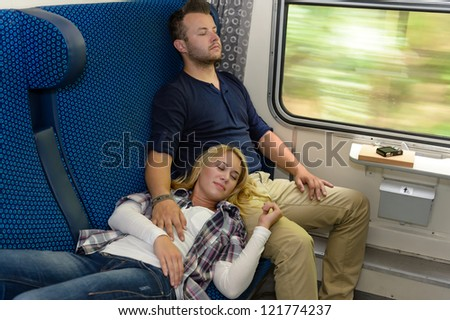 Couple sleeping in train woman man vacation romantic passengers laying - stock photo