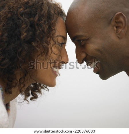 Couple smiling at each other - stock photo