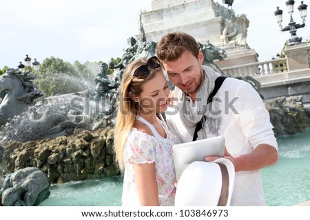 Couple standing by the fountain on the Quinconces Square in Bordeaux, France - stock photo