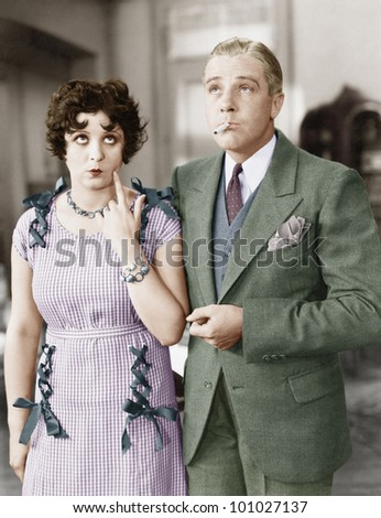 Couple standing together looking funny - stock photo