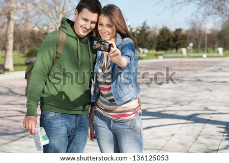 Couple take a picture together while  smiling and having fun - stock photo