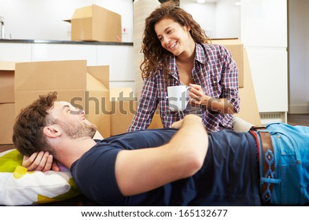 Couple Taking A Break During House Move - stock photo
