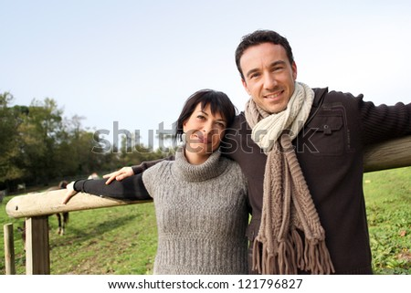 Couple taking a stroll in the countryside - stock photo