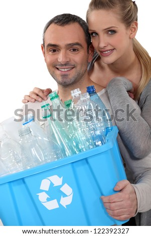 Couple taking out the recycling - stock photo