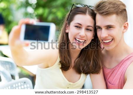 Couple taking selfie - stock photo