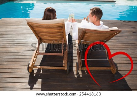 Couple toasting champagne by swimming pool against heart - stock photo