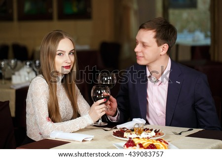 Couple toasting wineglasses in a luxury restaurant  - stock photo