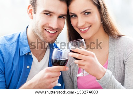 Couple toasting with red wine - stock photo