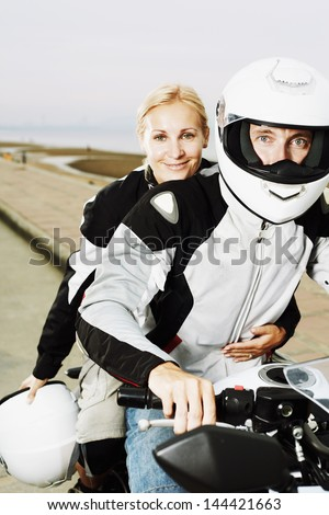 Couple two adult with motorcycle in riders clothes - stock photo