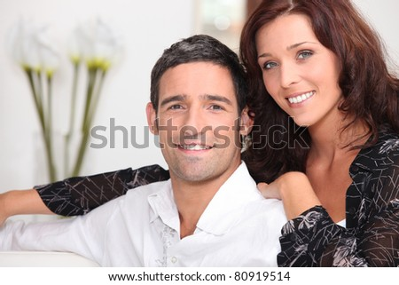 Couple unwinding at home - stock photo
