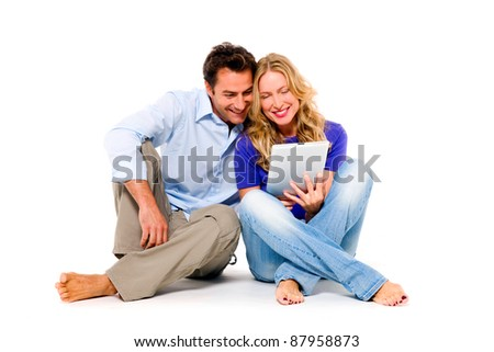 couple using digital tablet - stock photo