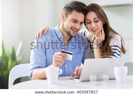 Couple using laptop together  - stock photo