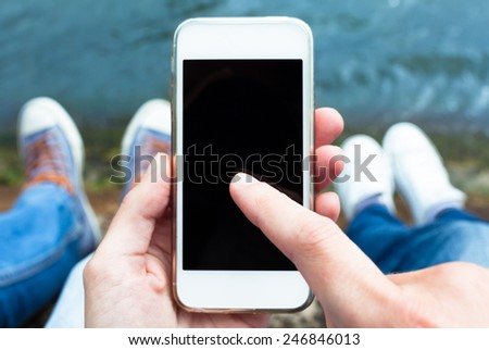 Couple using smart phone mobile - stock photo