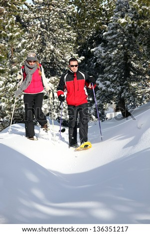 Couple walking in ski shoes - stock photo
