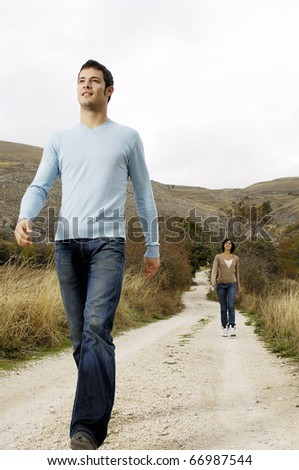 Couple walking in the country - stock photo