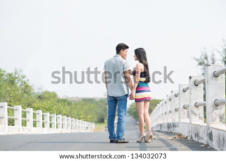 Couple walking on the road together - stock photo