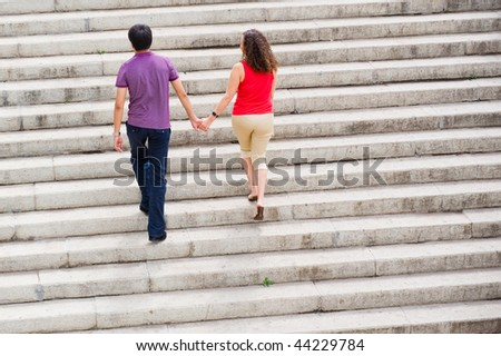 Couple walking out - stock photo