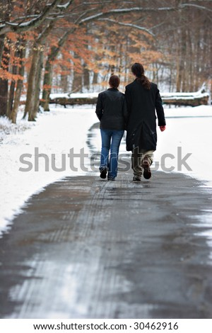 couple walking together - stock photo