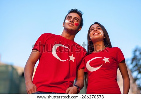 Couple wearing Turkish flag t-shirt - stock photo
