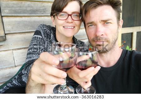 couple wine selfie farmstay holiday tasmania - stock photo