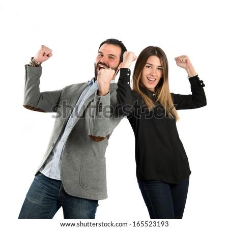 Couple winner over white background - stock photo