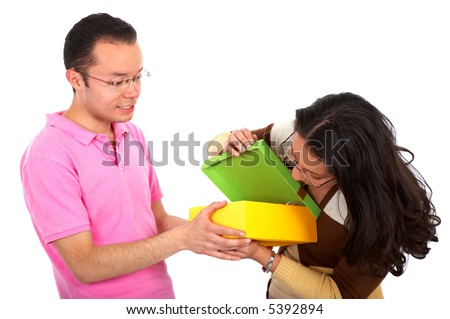 couple with a gift over a white background - stock photo