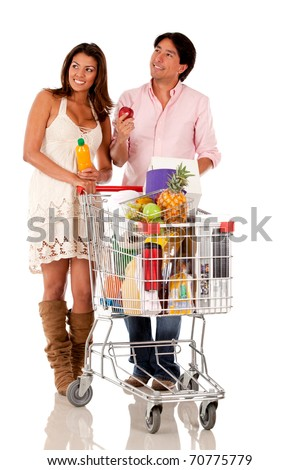 Couple with a shopping cart looking for groceries - isolated - stock photo