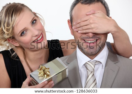 Couple with a surprise gift - stock photo