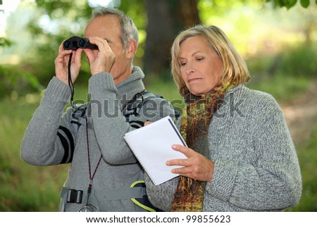 Couple with binoculars - stock photo