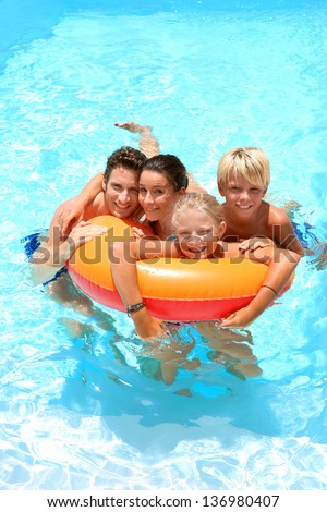 Couple with children enjoying bath time - stock photo