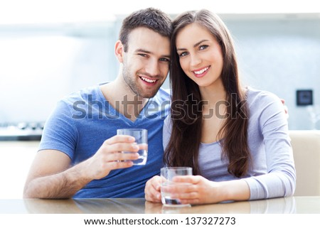 Couple with glasses of water - stock photo
