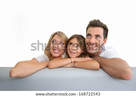 Couple with little girl looking at the top - stock photo