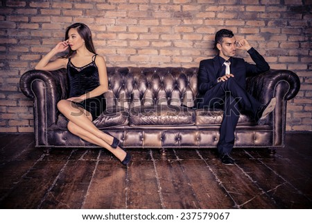 Couple with relationship problems - Two stylish lovers having couple problems - stock photo